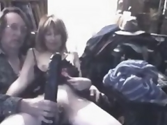 What do you think this insane mature wench feels, when massive darksome sex toy penetrates her large stretched cunt?