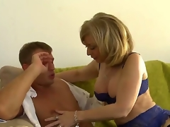 MILF Nina Hartley milks this boy, Bill Bailey dry. This sexy mature woman with great large tits looks astonishing in her sexy lingerie as that babe goes down on this young mans young dick and engulf him until he cums with her experienced mouth.
