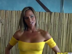 Shes a beautiful MILF with big fake tits and slim figure. Leggy well stacked woman in yellow blouse and blue skin tight jeans turns chap on. MILF Hunter cant resist! She is devilishly sexy