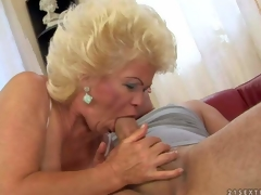 Effie is a blond-haired aged slut with fuckable titties. This babe strokes young hard dick with her nice juggs and then takes it in her mouth. This babe shows her hairy mature pussy while doing it