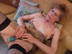 Mature in stockings and underware has dildo sex