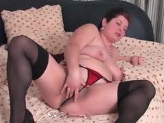 Fat mature in stockings and panties masturbates