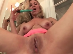 Mature plays with her tits and pussy in bathroom
