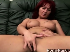Filthy redhead MILF with huge boobs goes horny on the couch