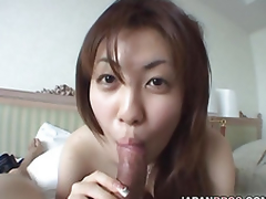 Naturally breasted Japanese chick gives a blowjob to a dick